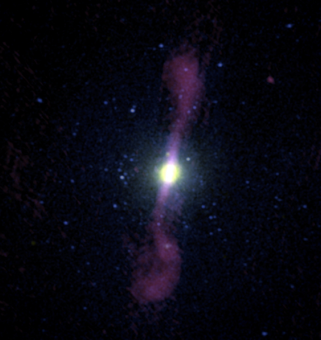 This image shows a composite view of the giant elliptical galaxy NGC 1399. Copyright: Digitised Sky Survey/NASA Chandra/Very Large Array (Robert Dunn et al. 2010)